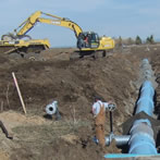 water pipe and excavator
