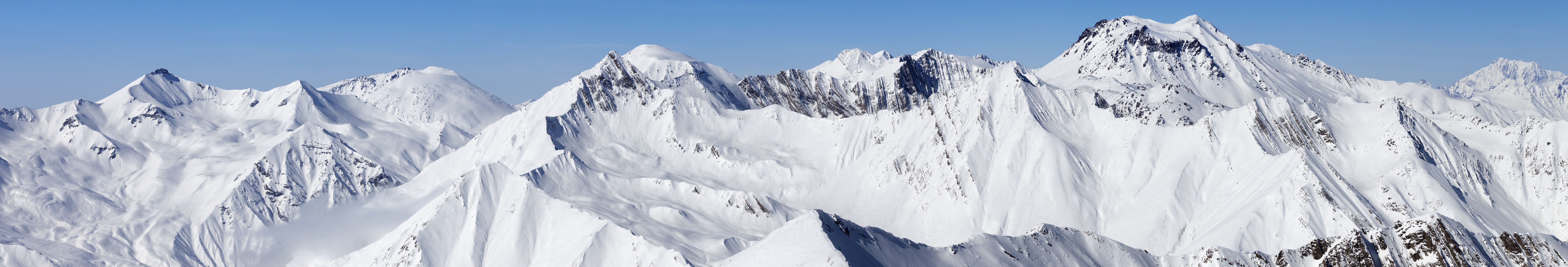 Panorama of snowy mountain peaks